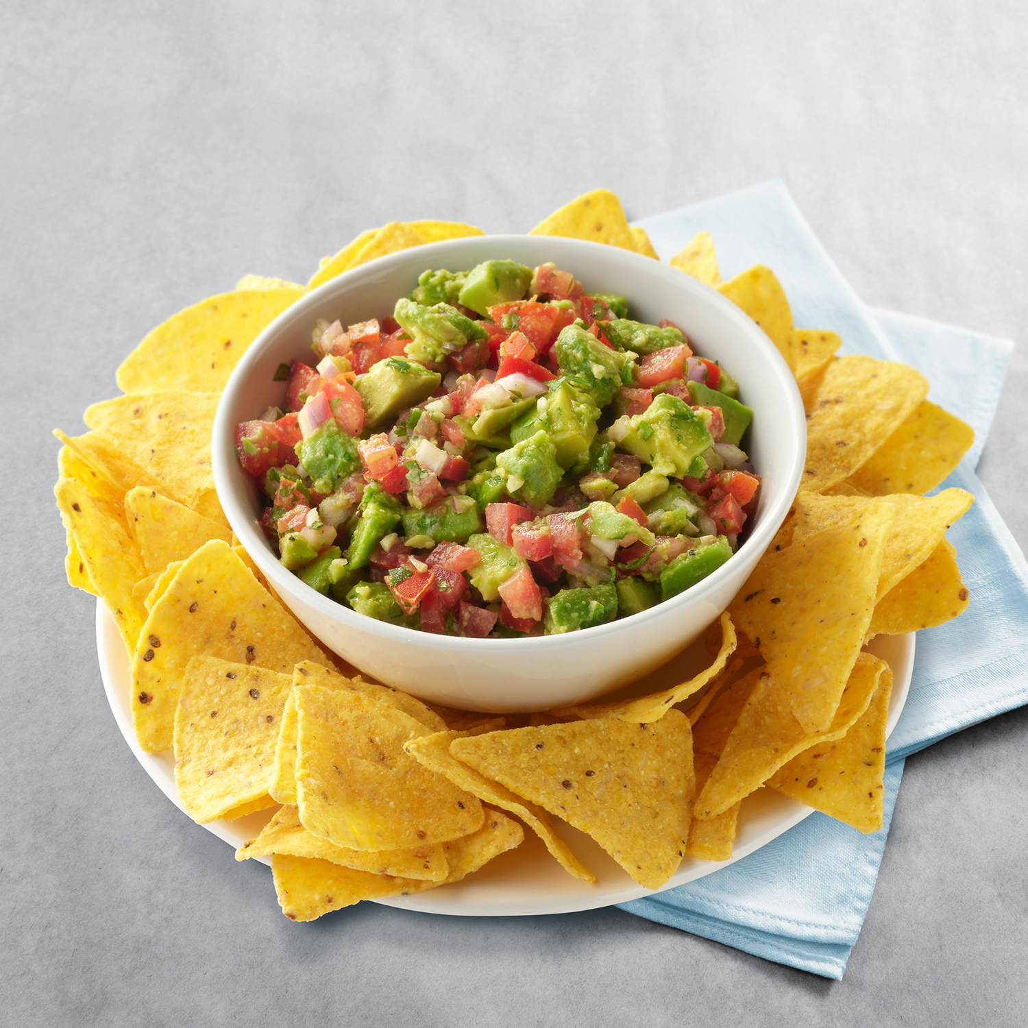 Eat Wholly avocado and salsa dip with chips